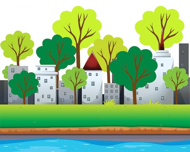 Bâtiments de la ville et arbres le long de la rivière Vecteur gratuit