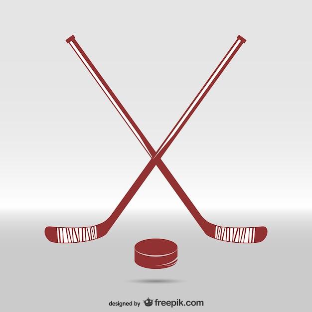 Bâtons De Hockey Et Une Rondelle Vecteur gratuit
