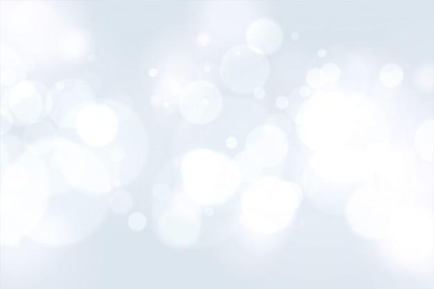 Beau Blanc Avec Effet De Lumière Bokeh Vecteur gratuit
