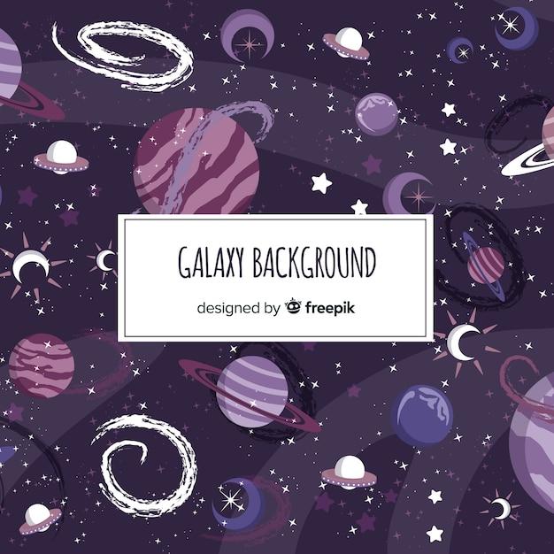 Beau fond de galaxie dessiné à la main Vecteur gratuit