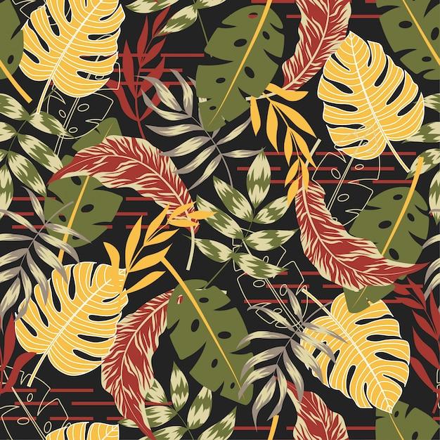 Beau modèle sans couture avec des plantes tropicales et des feuilles Vecteur Premium
