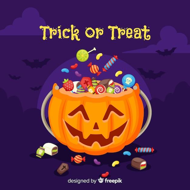 Beau sac de bonbons d'halloween avec un design plat Vecteur gratuit