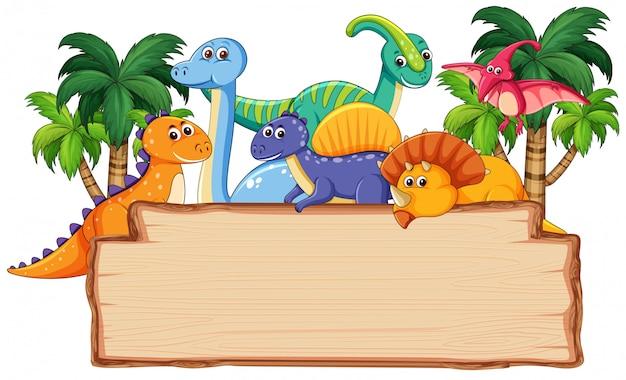Beaucoup de dinosaures sur une planche de bois Vecteur Premium