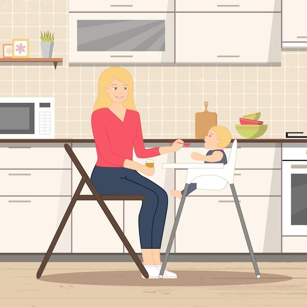 Bébé nourrir dans la cuisine Vecteur Premium
