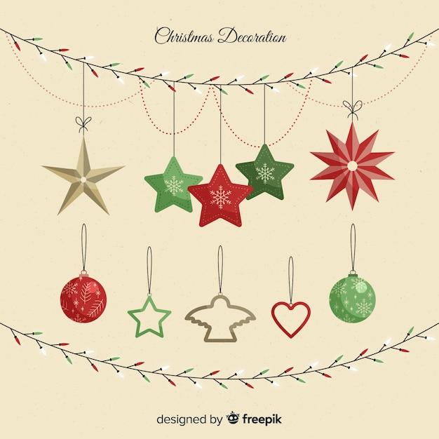Belle décoration de noël avec des étoiles et des boules Vecteur gratuit