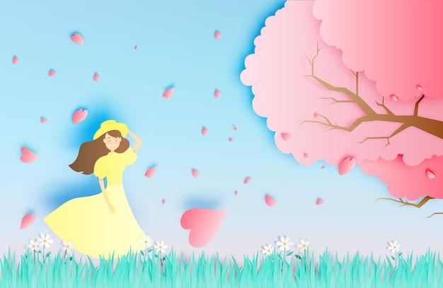 Belle fille avec arbre de fleurs de cerisier dans l'illustration vectorielle d'herbe champ papier art style Vecteur Premium