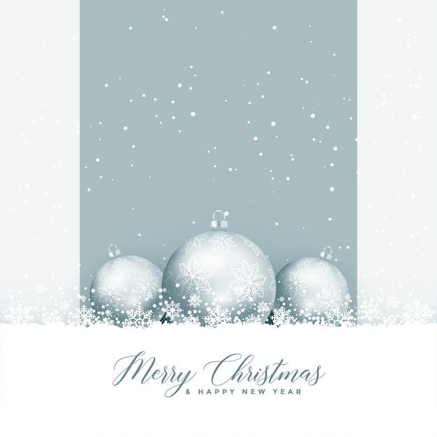 Belle joyeux noël voeux avec des boules et des flocons de neige Vecteur gratuit