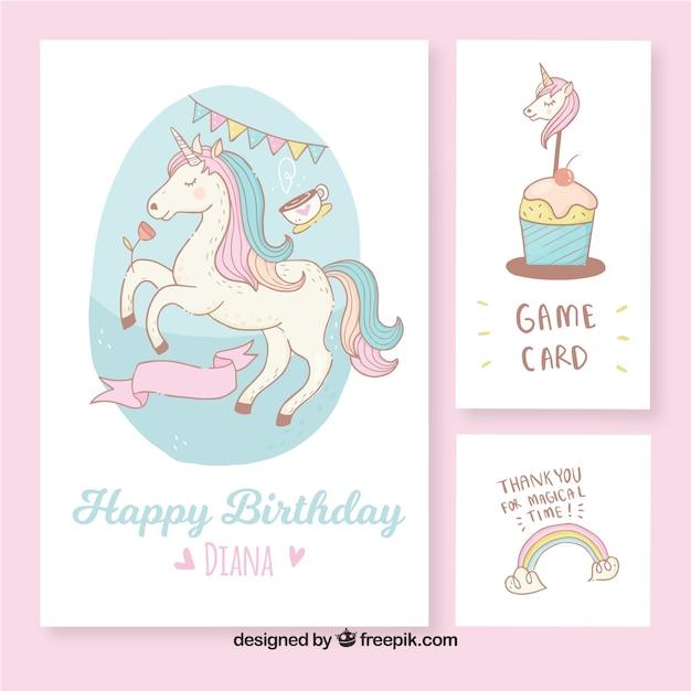 Belles cartes d'anniversaire avec une licorne dessinée à la main Vecteur gratuit
