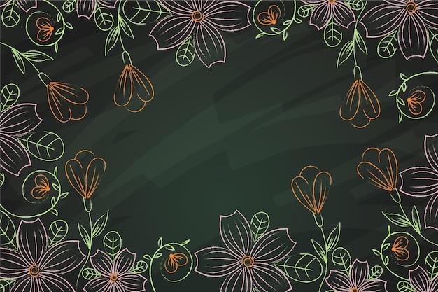 Belles Fleurs Dessinées à La Main Sur Fond De Tableau Noir Vecteur gratuit