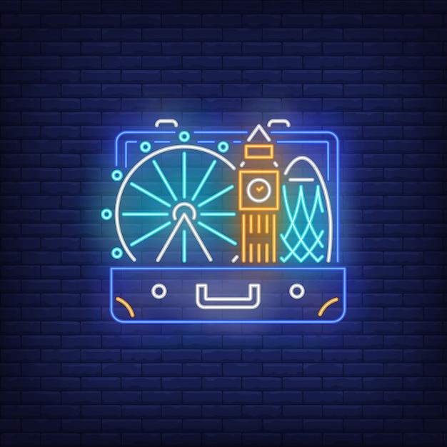 Big ben, london eye dans une enseigne au néon de la valise ouverte Vecteur gratuit