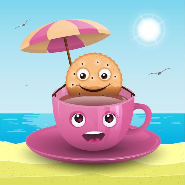 Un biscuit dans une tasse sur la plage. Vecteur Premium