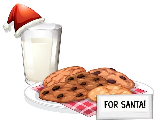 Biscuits au lait frais et au chocolat pour le père noël Vecteur gratuit