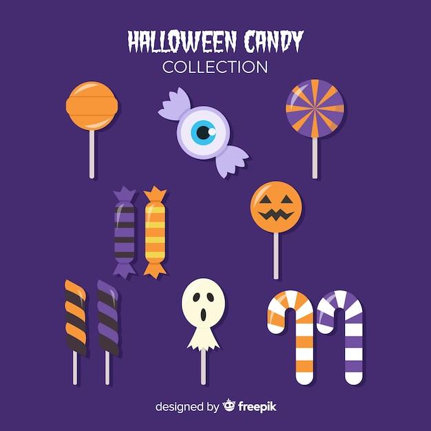 Bonbons savoureux pour la nuit d'halloween sur fond violet Vecteur gratuit