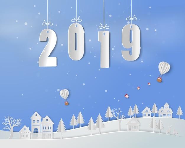 Bonne année 2019 sur fond d'art en papier Vecteur Premium