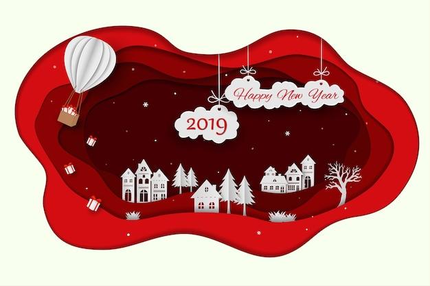 Bonne année 2019 sur fond de papier art rouge Vecteur Premium