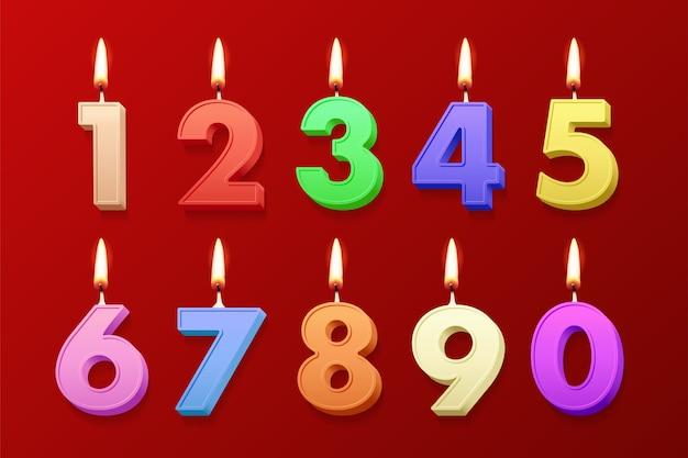 Bougies D'anniversaire Réalistes De Couleur Différente Avec Des Flammes Brûlantes Sur Fond Rouge. Vecteur Premium