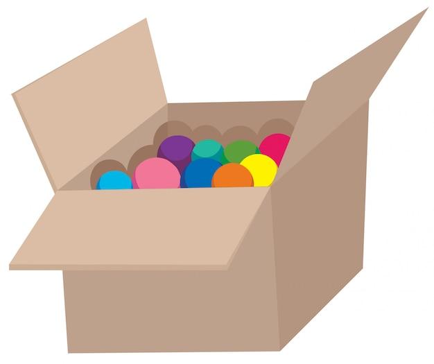 Boule colorée dans une boîte en carton ondulé Vecteur gratuit
