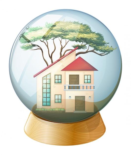 Une boule de cristal mignonne avec une grande maison à l'intérieur Vecteur gratuit