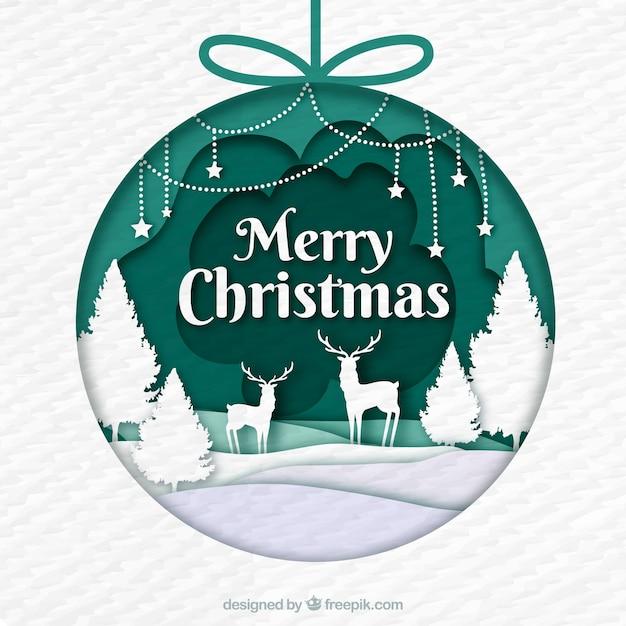 Boule de Noël décorée d'une scène en style papier Vecteur gratuit