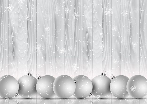 Boules De Noël Sur Un Flocon De Neige Décoratif Et Fond En Bois Vecteur Premium