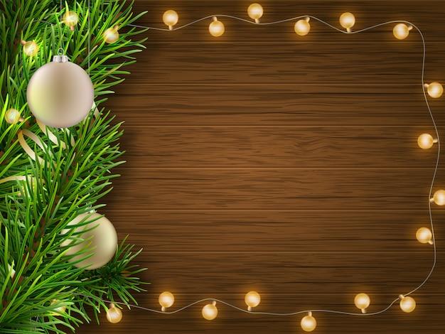Branche de pin guirlande sur bois Vecteur Premium