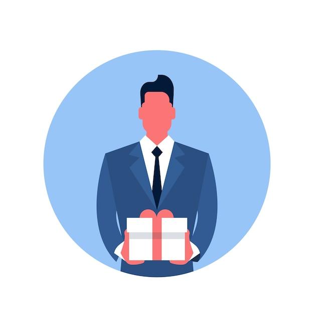 Business man tenir l'icône de la boîte présente Vecteur Premium