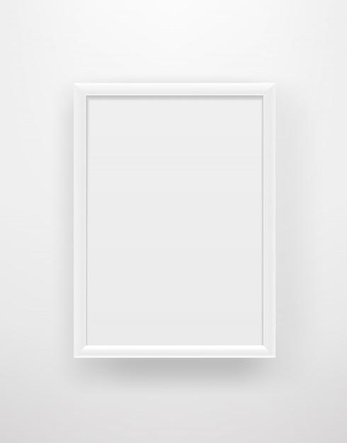 Cadre Blanc Vide Sur Un Mur Blanc Vecteur Premium