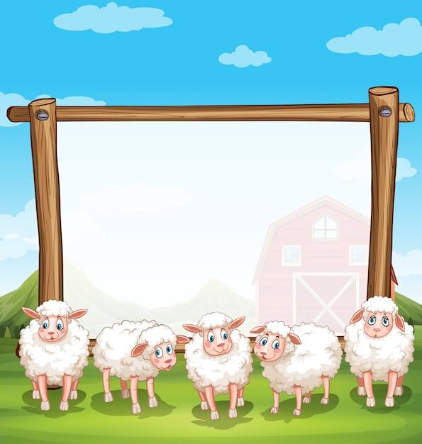 Cadre en bois avec des moutons à la ferme Vecteur gratuit