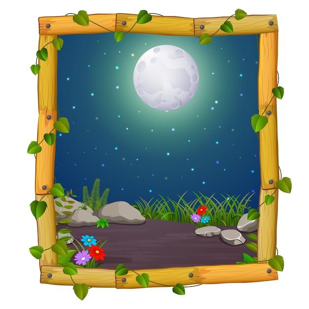 Cadre en bois avec la scène de la nature et une pleine lune Vecteur Premium