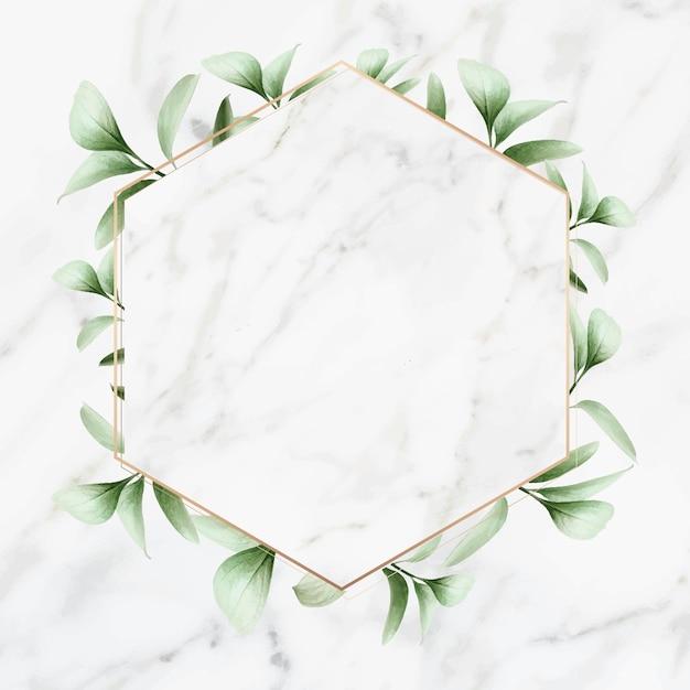 Cadre doré sur fond de marbre Vecteur Premium