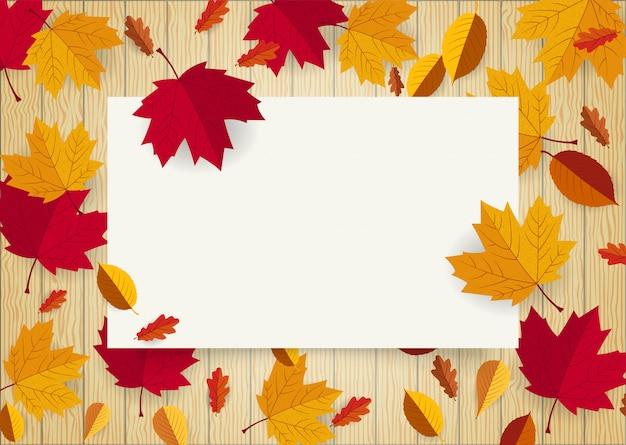 Cadre d'espace de papier blanc vierge décorée avec une feuille qui tombe Vecteur Premium