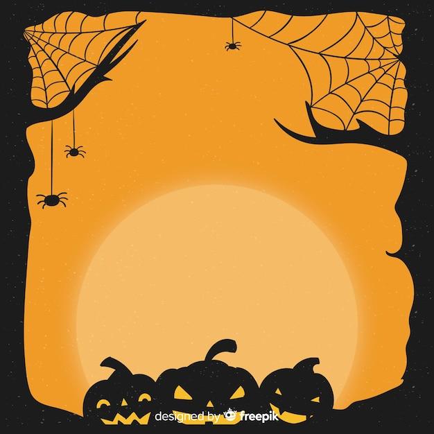 Cadre d'halloween dessiné avec des citrouilles à la main Vecteur gratuit