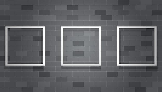Cadre d'image vide accroché au mur de briques grises Vecteur Premium