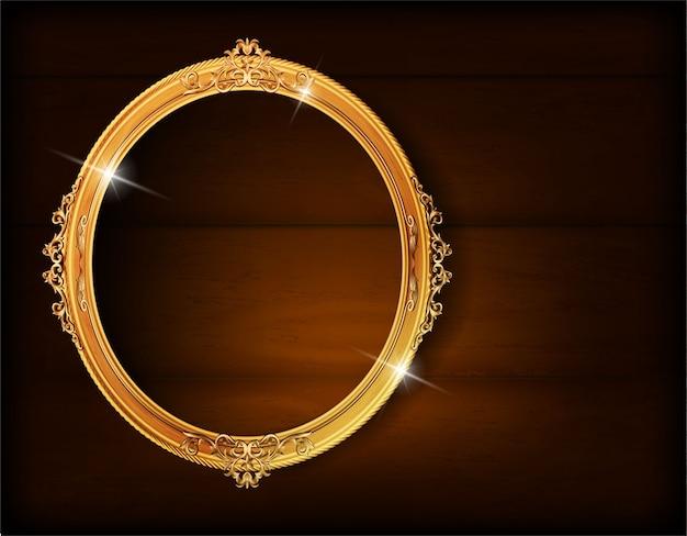 Cadre ovale de photo d'or sur le mur en bois Vecteur Premium