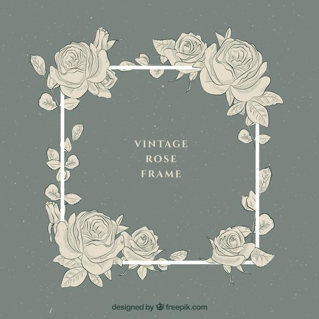 Cadre vintage avec des roses dessinées à la main Vecteur gratuit