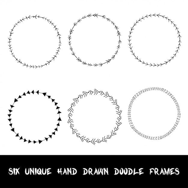 Cadres ornementaux doodle dessinés à la main. Vecteur Premium