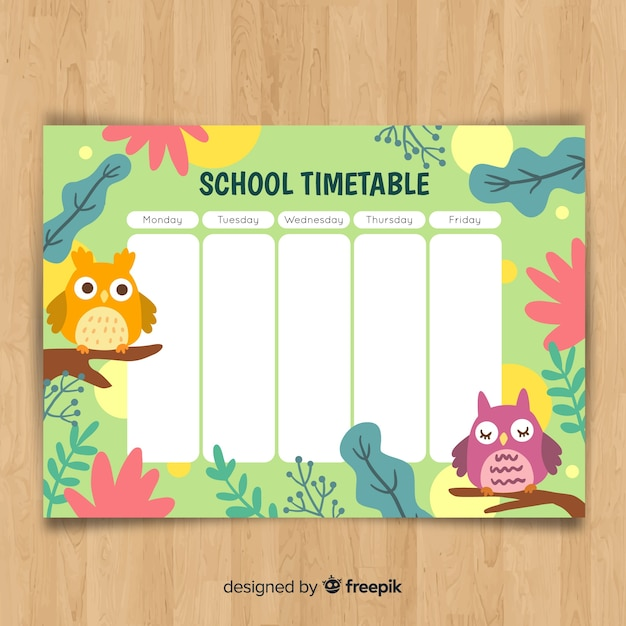 Calendrier scolaire dessiné à la main avec des animaux Vecteur gratuit
