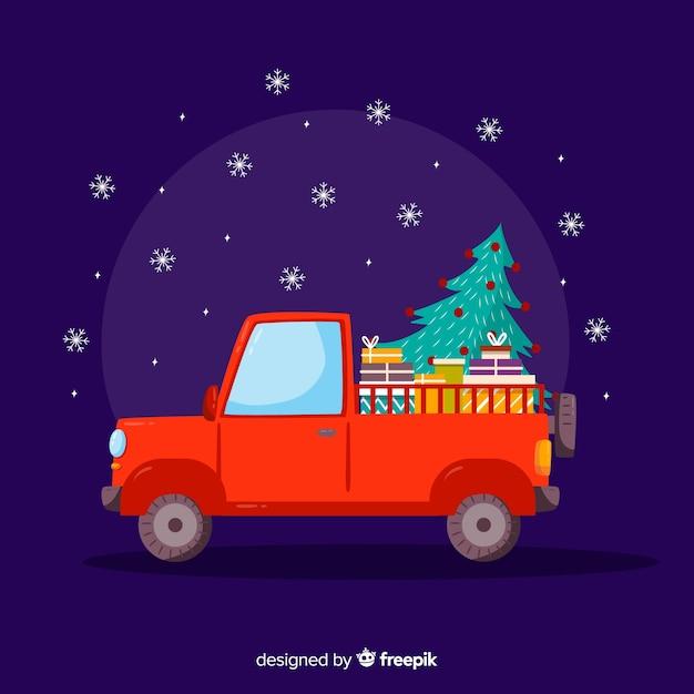 Camionnette avec arbre de noël Vecteur gratuit