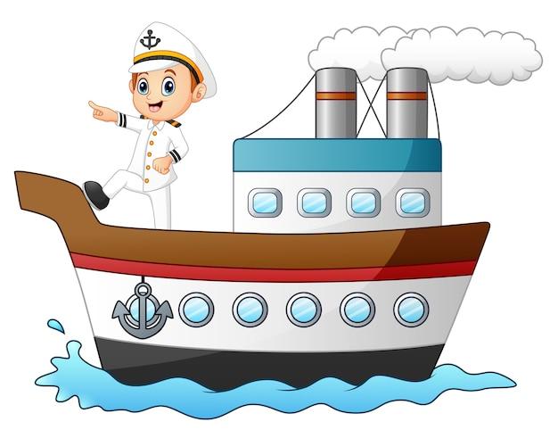 Capitaine De Bateau De Dessin Anime Pointant Sur Un Navire Vecteur Premium