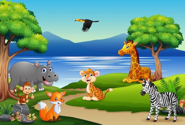 Caricature d'animaux heureux sur la scène de la nature Vecteur Premium