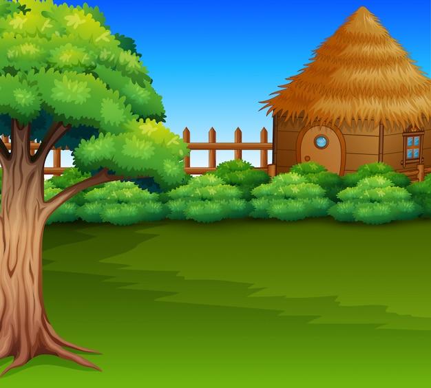 Caricature de la cabane en bois dans un champ vert Vecteur Premium
