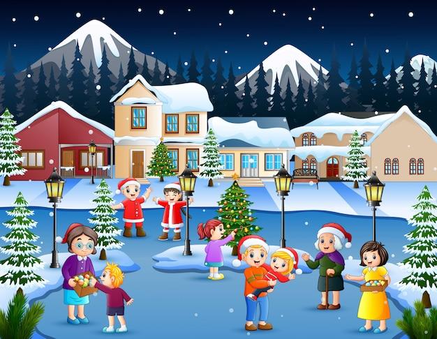Caricature d'enfant heureux et famille jouant dans le village de neige Vecteur Premium