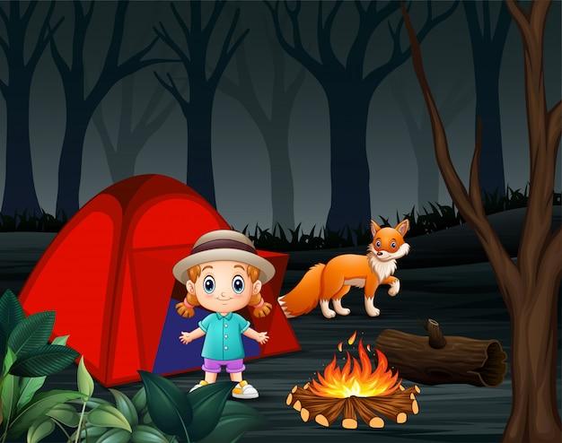 Caricature d'une petite fille et d'un renard dans un camping Vecteur Premium
