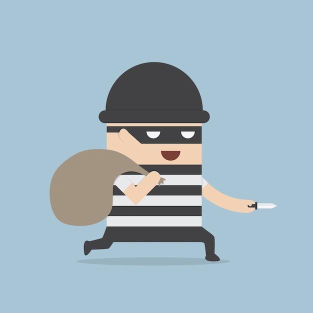 Caricature de voleur tenant le couteau dans sa main et portant un sac d'argent Vecteur Premium