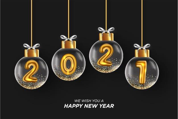 Carte De Bonne Année 2021 Avec Boule De Noël Réaliste Fond Noir Vecteur gratuit