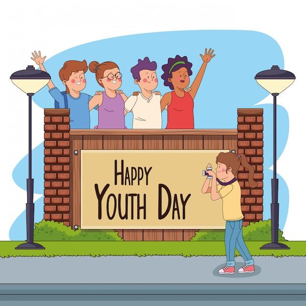 Carte de bonne fête de la jeunesse avec des dessins animés d'adolescents Vecteur gratuit