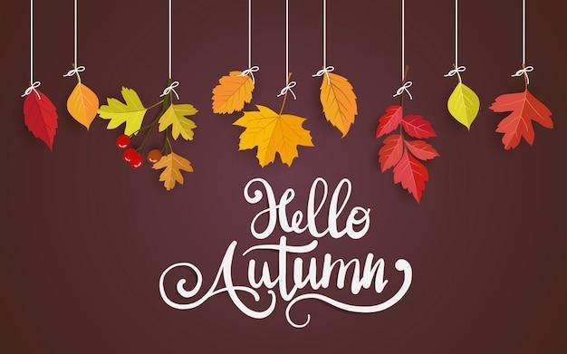 Carte brune avec des feuilles d'automne suspendue à un fil Vecteur Premium