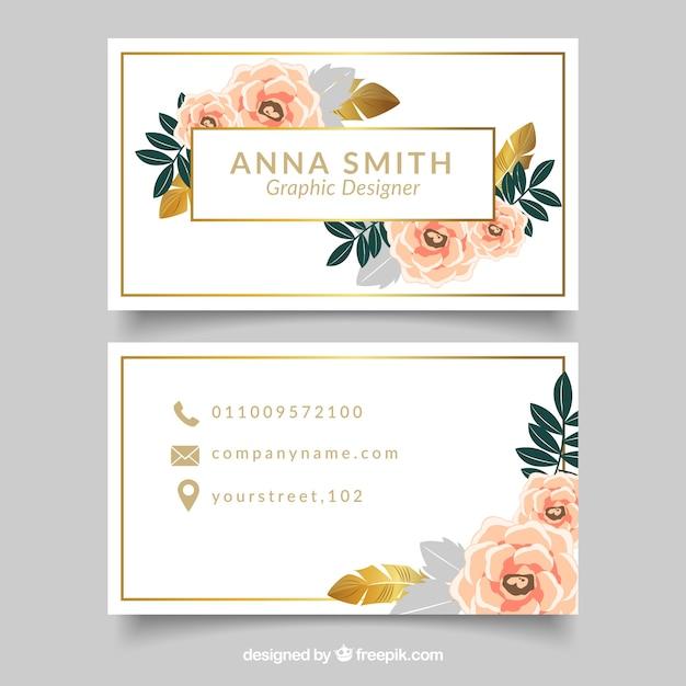 Carte d'entreprise élégante avec des fleurs et des détails dorés Vecteur gratuit