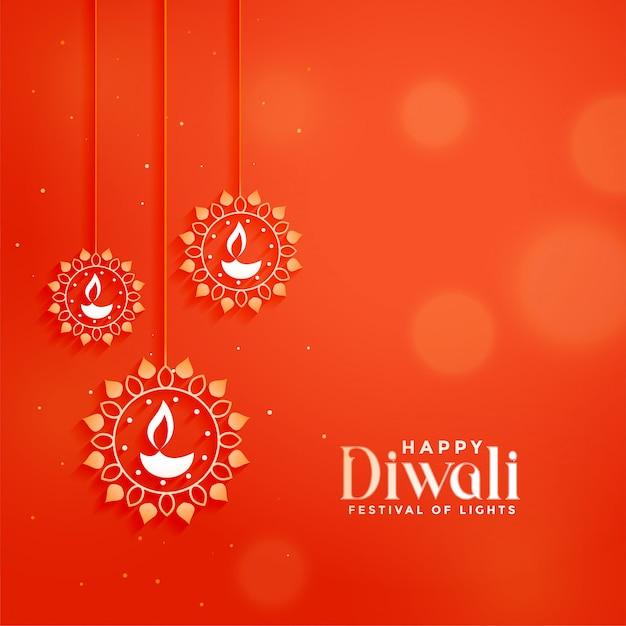 Carte de fête diwali orange avec lampes diya suspendues Vecteur gratuit