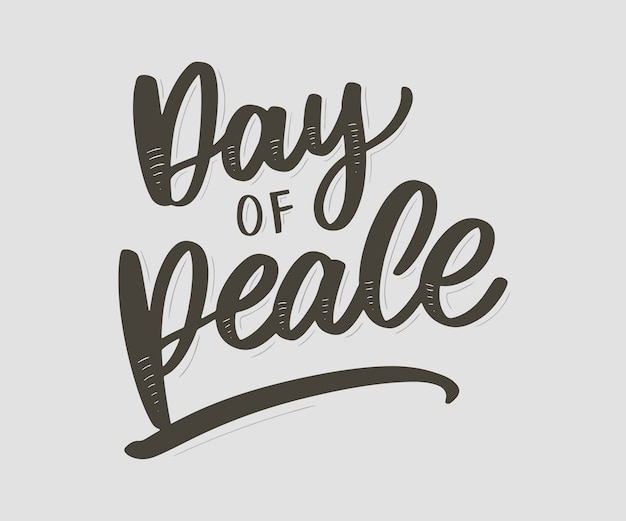 Carte de la journée internationale de la paix. illustration de lettrage écrite à la main. Vecteur Premium